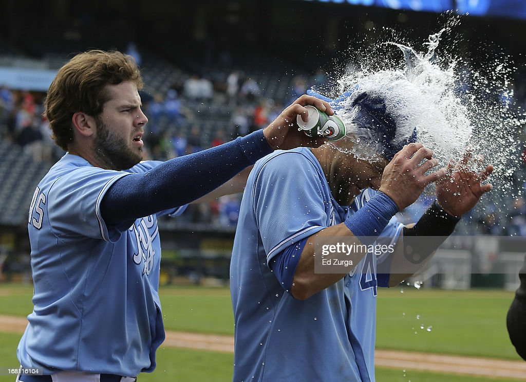 <a gi-track='captionPersonalityLinkClicked' href=/galleries/search?phrase=Alex+Gordon+-+Baseball+Player&family=editorial&specificpeople=4494252 ng-click='$event.stopPropagation()'>Alex Gordon</a> (R) of the Kansas City Royals is doused with cups of water from teammate <a gi-track='captionPersonalityLinkClicked' href=/galleries/search?phrase=Mike+Moustakas&family=editorial&specificpeople=6780077 ng-click='$event.stopPropagation()'>Mike Moustakas</a> as they celebrate a 6-5 win in 10 inning against the Chicago White Sox at Kauffman Stadium on May 5, 2013 in Kansas City, Missouri.