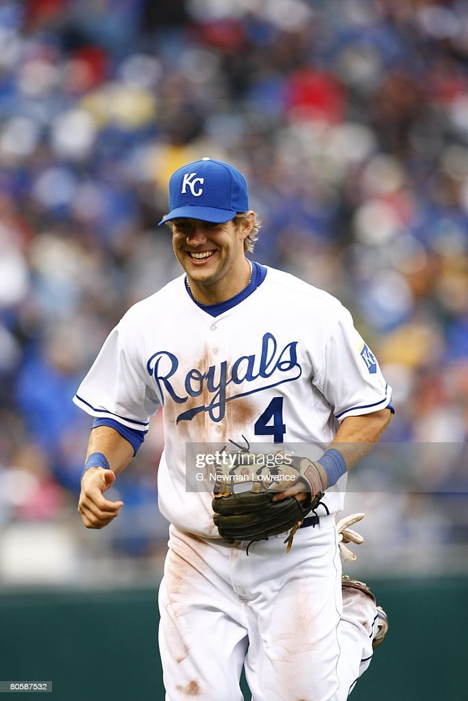 Alex Gordon #4 of the Kansas City Royals laughs as he runs off the field during the game against the New York Yankees on April 8, 2008 at Kauffman Stadium in Kansas City, Missouri.