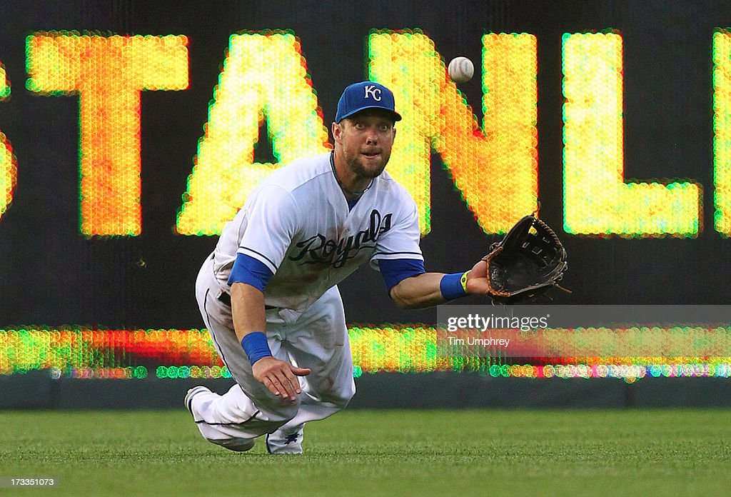 <a gi-track='captionPersonalityLinkClicked' href=/galleries/search?phrase=Alex+Gordon+-+Baseball+Player&family=editorial&specificpeople=4494252 ng-click='$event.stopPropagation()'>Alex Gordon</a> #4 of the Kansas City Royals makes a diving catch in a game against the Atlanta Braves at Kauffman Stadium on June 25, 2013 in Kansas City, Missouri. The Braves defeated the Royals 4-3.