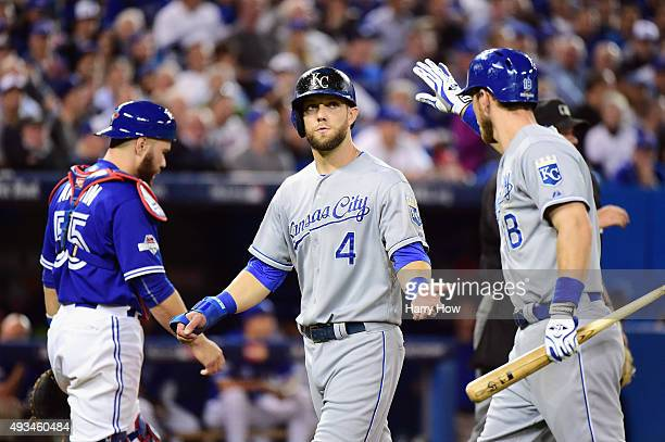 Alex Gordon of the Kansas City Royals reacts after scoring a run in the seventh inning against the Toronto Blue Jays during game four of the American...
