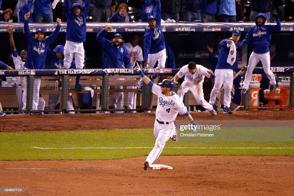 Alex Gordon of the Kansas City Royals reacts as he runs the bases after hitting a solo home run in the ninth inning to tie the game against the New...