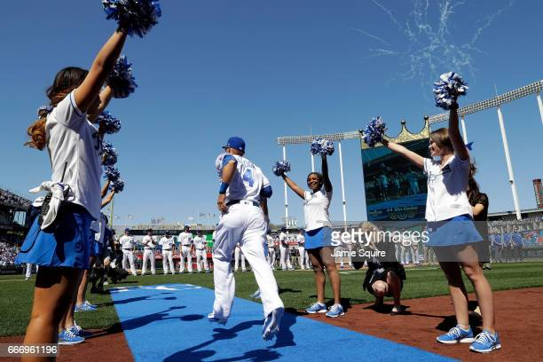 Alex Gordon of the Kansas City Royals runs out of the dugout during player introductions prior to the Royals 2017 home opener against the Oakland...