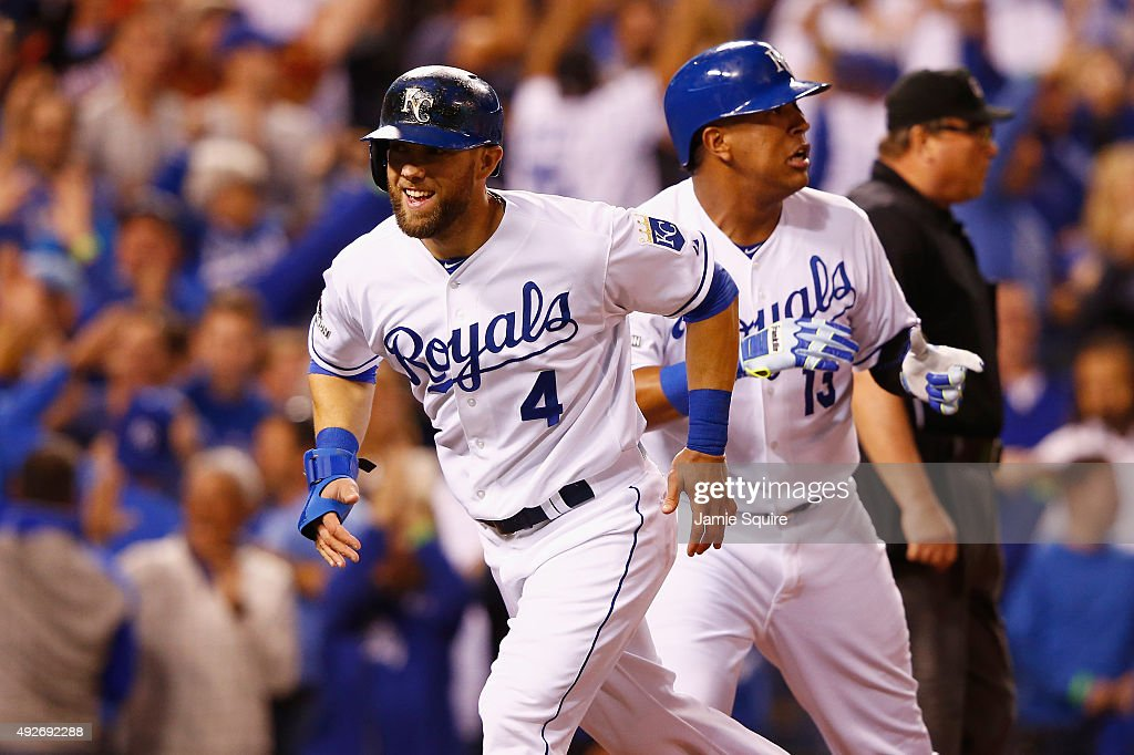 Alex Gordon #4 of the Kansas City Royals scores a run as Salvador Perez #13 of the Kansas City Royals looks on in the fifth inning against the Houston Astros during game five of the American League Divison Series at Kauffman Stadium on October 14, 2015 in Kansas City, Missouri.