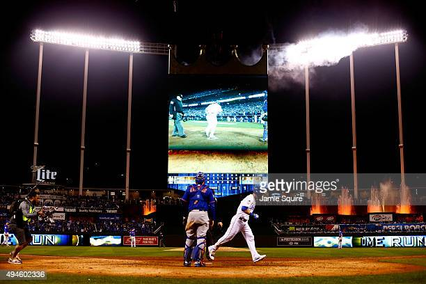 Alex Gordon of the Kansas City Royals scores after hitting a solo home run in the ninth inning against the New York Mets during Game One of the 2015...