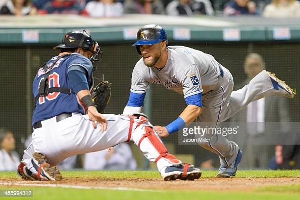 Alex Gordon of the Kansas City Royals scores ahead of the tag by catcher Yan Gomes of the Cleveland Indians in the fourth inning at Progressive Field...