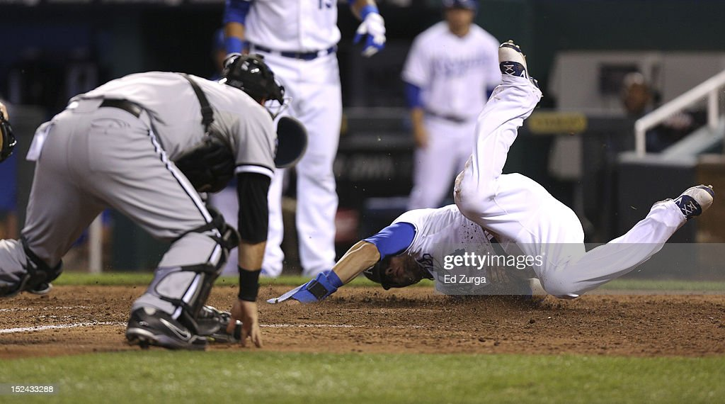 <a gi-track='captionPersonalityLinkClicked' href=/galleries/search?phrase=Alex+Gordon+-+Baseball+Player&family=editorial&specificpeople=4494252 ng-click='$event.stopPropagation()'>Alex Gordon</a> #4 of the Kansas City Royals slides into home as he scores past <a gi-track='captionPersonalityLinkClicked' href=/galleries/search?phrase=A.J.+Pierzynski&family=editorial&specificpeople=204486 ng-click='$event.stopPropagation()'>A.J. Pierzynski</a> #12 of the Chicago White Sox in the sixth inning at Kauffman Stadium on September 20, 2012 in Kansas City, Missouri.
