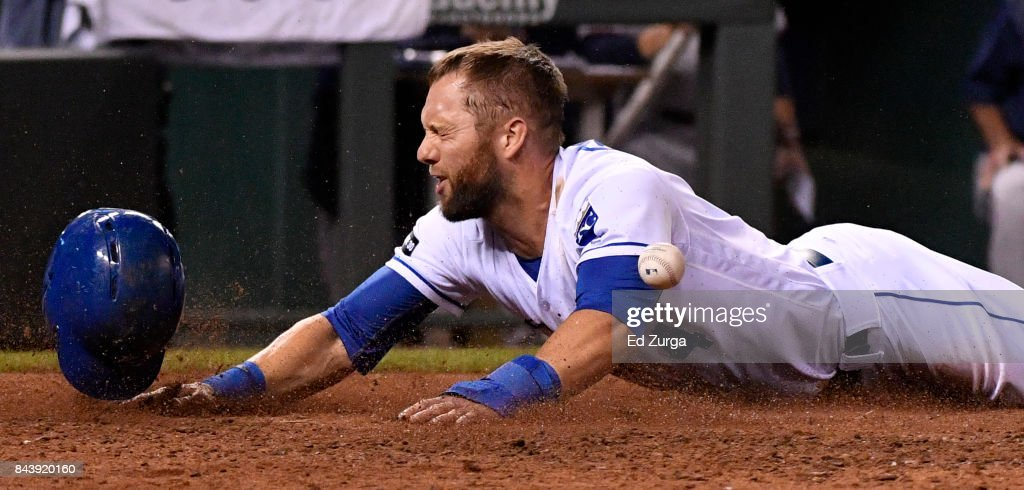 Alex Gordon #4 of the Kansas City Royals slides into home to score against the Minnesota Twins in the fifth inning at Kauffman Stadium on September 7, 2017 in Kansas City, Missouri.