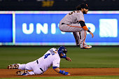 Alex Gordon of the Kansas City Royals slides into second base as Brandon Crawford of the San Francisco Giants tries to make the play during Game...