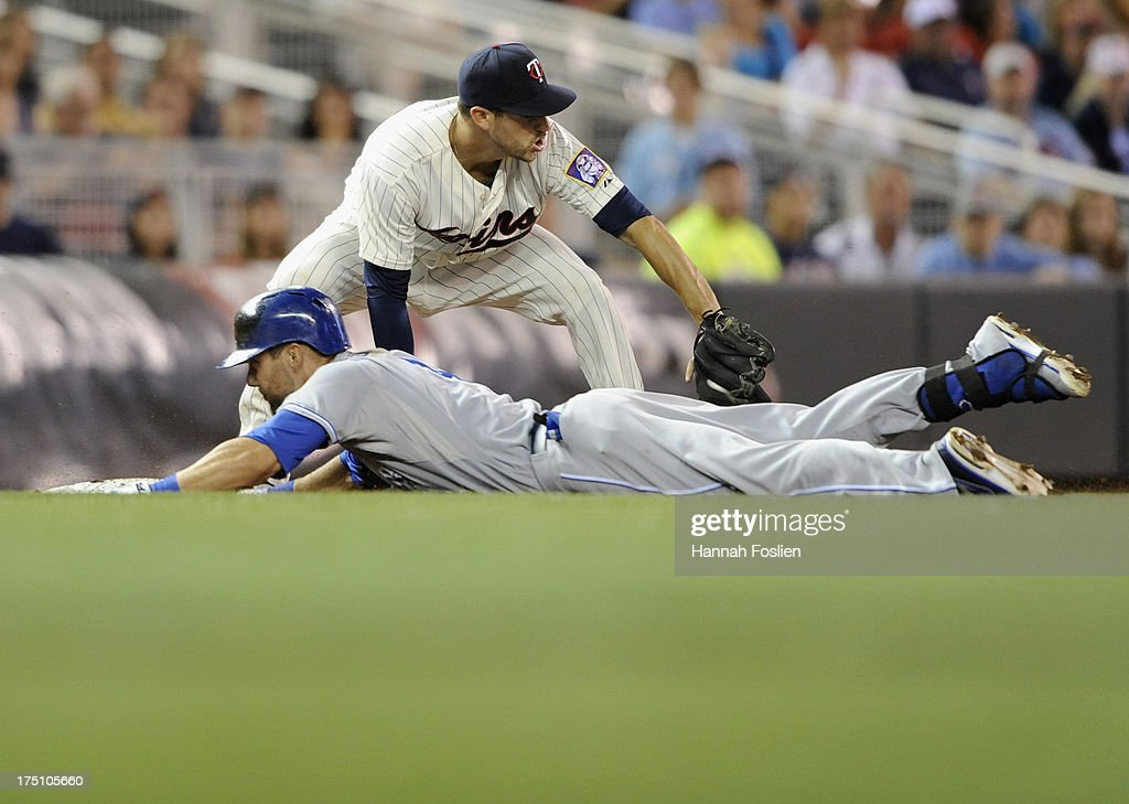 <a gi-track='captionPersonalityLinkClicked' href=/galleries/search?phrase=Alex+Gordon+-+Baseball+Player&family=editorial&specificpeople=4494252 ng-click='$event.stopPropagation()'>Alex Gordon</a> #4 of the Kansas City Royals slides into third base safely as <a gi-track='captionPersonalityLinkClicked' href=/galleries/search?phrase=Trevor+Plouffe&family=editorial&specificpeople=5722348 ng-click='$event.stopPropagation()'>Trevor Plouffe</a> #24 of the Minnesota Twins fields the ball during the seventh inning of the game on July 31, 2013 at Target Field in Minneapolis, Minnesota.