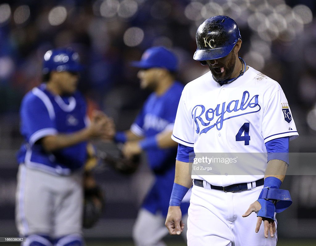 <a gi-track='captionPersonalityLinkClicked' href=/galleries/search?phrase=Alex+Gordon+-+Baseball+Player&family=editorial&specificpeople=4494252 ng-click='$event.stopPropagation()'>Alex Gordon</a> #4 of the Kansas City Royals walks off the field after their 3-2 loss to the Toronto Blue Jays at Kauffman Stadium April 13, 2013 in Kansas City, Missouri.