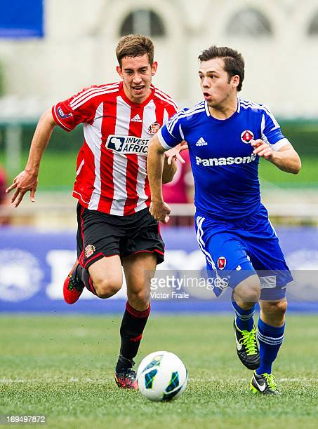 Alex Gorrin of Sunderland and Stephen Liu Gar Lock of South China fight for the ball on day three of the Hong Kong International Soccer Sevens at...