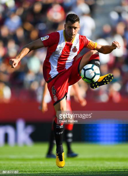 Alex Granell of Girona FC runs with the ball during the La Liga match between Girona and Villarreal at Estadi de Montilivi on October 15 2017 in...