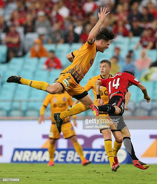 Alex Grant of the Glory and Jumpei Kusukami of the Wanderers compete for the ball during the round 13 ALeague match between the Western Sydney...