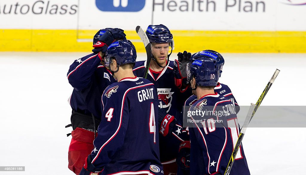 Alex Grant #4 of the Springfield Falcons celebrates his goal with teammates Jordan Szwarf #10, Matthias Plakat #22, Ross Mauermann #41 and Philip Samuelson #5 during an American Hockey League game against the Providence Bruins at the Dunkin' Donuts Center on November 1, 2015 in Providence, Rhode Island. The Falcons won 5-2.