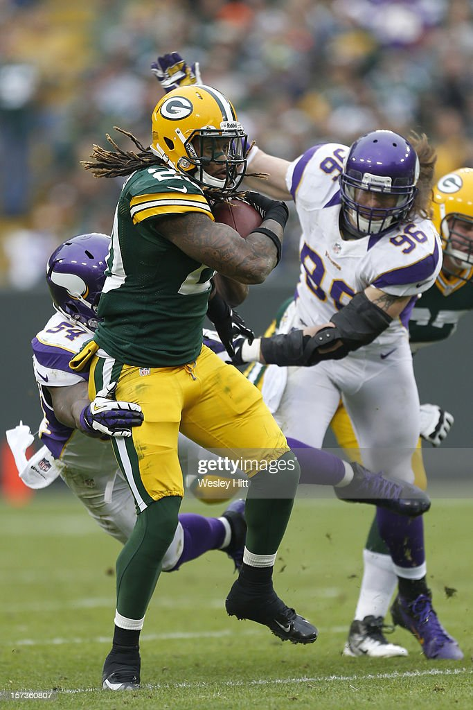 <a gi-track='captionPersonalityLinkClicked' href=/galleries/search?phrase=Alex+Green&family=editorial&specificpeople=6683075 ng-click='$event.stopPropagation()'>Alex Green</a> #20 of the Green Bay Packers is tackled by <a gi-track='captionPersonalityLinkClicked' href=/galleries/search?phrase=Jasper+Brinkley&family=editorial&specificpeople=4032417 ng-click='$event.stopPropagation()'>Jasper Brinkley</a> #54 of the Minnesota Vikings at Lambeau Field on December 2, 2012 in Green Bay, Wisconsin. The Packers defeated the Vikings 23-14.