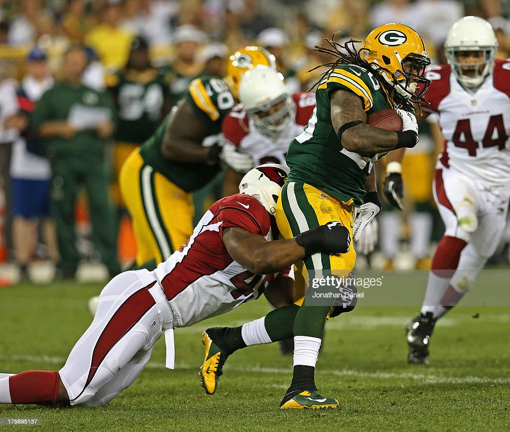 <a gi-track='captionPersonalityLinkClicked' href=/galleries/search?phrase=Alex+Green&family=editorial&specificpeople=6683075 ng-click='$event.stopPropagation()'>Alex Green</a> #20 of the Green Bay Packers is tackled by Kenny Demens #45 of the Arizona Cardinals at Lambeau Field on August 9, 2013 in Green Bay, Wisconsin.
