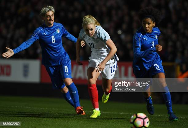 Alex Greenwood of England is pursued by Melania Gabbiadini and Sara Gama of Italy during the Women's International friendly match between England and...