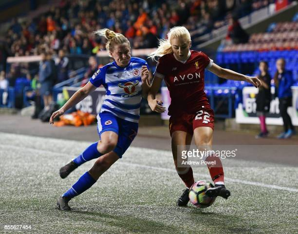 Alex Greenwood of Liverpool Ladies competes with Rachel Rowe of Reading FC Women during the Women's Super League match between Liverpool Ladies and...