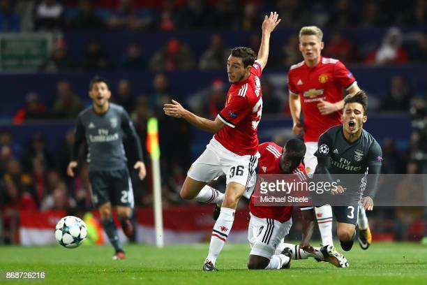 Alex Grimaldo of Benfica is fouled by Eric Bailly of Manchester United during the UEFA Champions League group A match between Manchester United and...