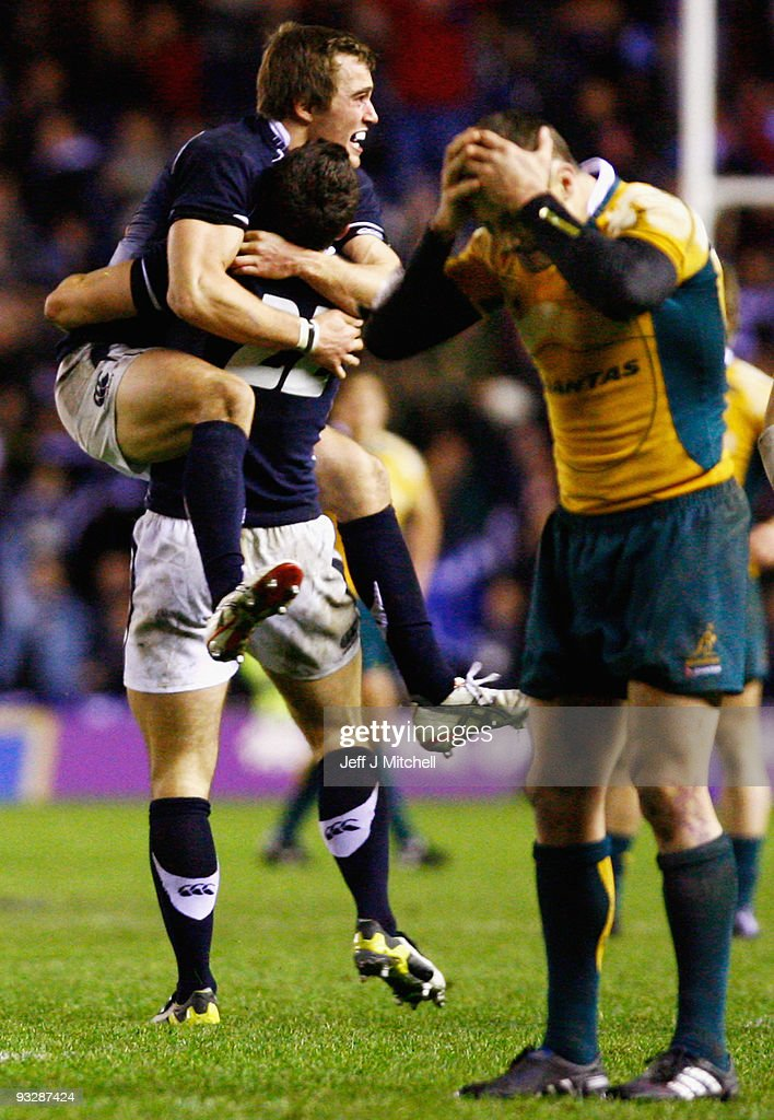 Alex Grove and Nic de Luca of Scotland celebrate as <a gi-track='captionPersonalityLinkClicked' href=/galleries/search?phrase=Matt+Giteau&family=editorial&specificpeople=206460 ng-click='$event.stopPropagation()'>Matt Giteau</a> of Australia reacts to his missed conversion during the Bank Of Scotland Corporate Autumn Tests match between Scotland and Australia at Murrayfield on November 21, 2009 in Edinburgh, Scotland.