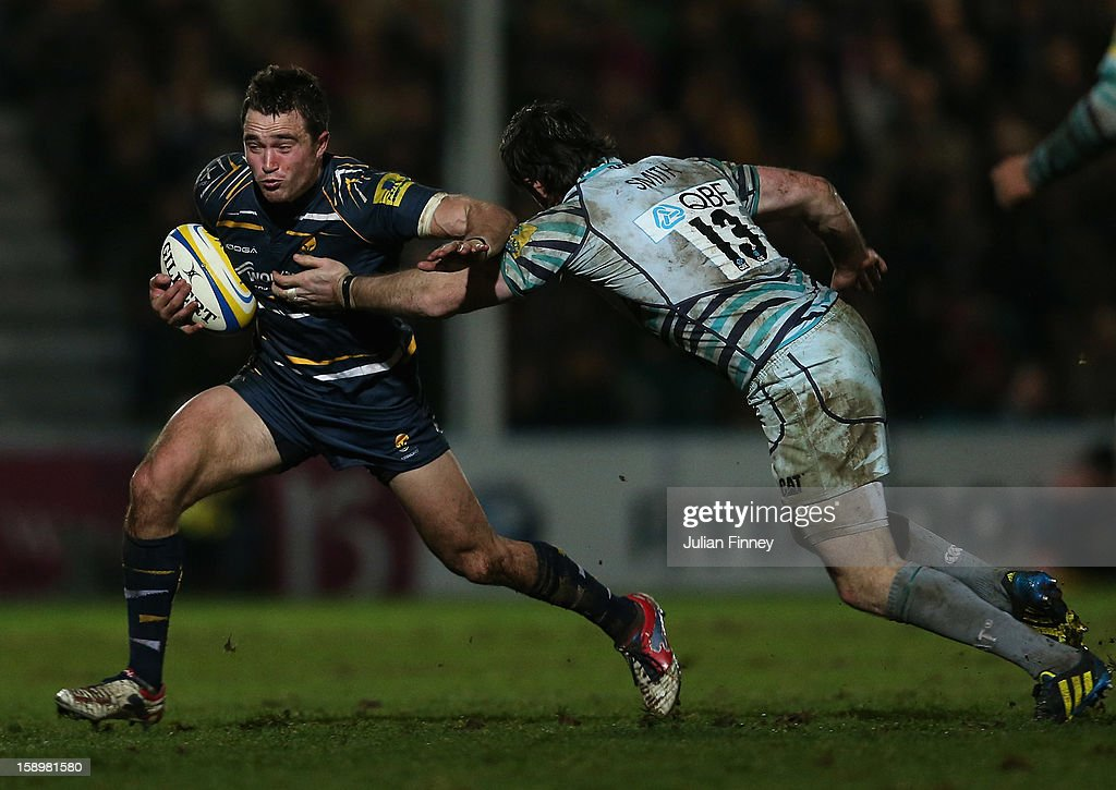 <a gi-track='captionPersonalityLinkClicked' href=/galleries/search?phrase=Alex+Grove&family=editorial&specificpeople=4950169 ng-click='$event.stopPropagation()'>Alex Grove</a> of Worcester is tackled by Matt Smith of Leicester during the Aviva Premiership match between Worcester Warriors and Leicester Tigers at Sixways Stadium on January 4, 2013 in Worcester, England.