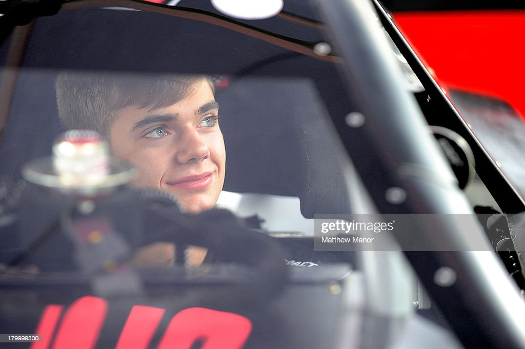 Alex Guenette, driver of the #39 Motos Illimitees/DLGL/Polaris Dodge car, waits in his car prior to practice for the NASCAR Canadian Tire Series race at Barrie Speedway on September 7, 2013 in Oro Station, Ontario, Canada.