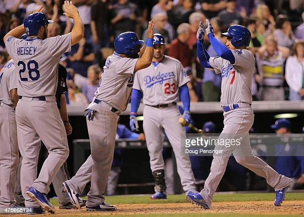 Alex Guerrero of the Los Angeles Dodgers celebrates his game winning grand slam off of Rafael Betancourt of the Colorado Rockies with Alberto...