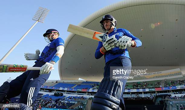 Alex Hales and Jason Roy of England walk out to bat ahead of the 2nd One Day International between Pakistan and England at Zayed Cricket Stadium on...