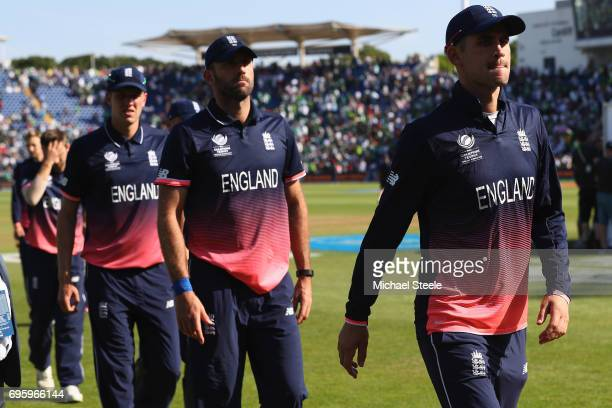 Alex Hales Liam Plunkett and Jake Ball of England walk from the field after their 8 wickets defeat during the ICC Champions Trophy SemiFinal match...