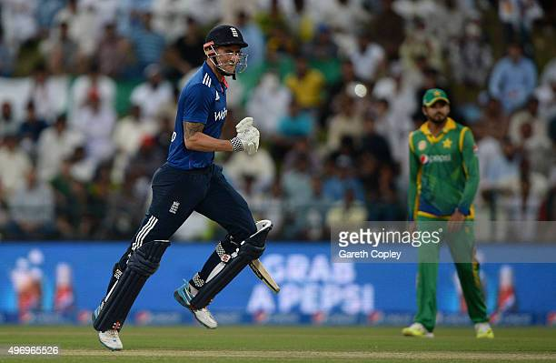 Alex Hales of England celebrates reaching his century during the 2nd One Day International between Pakistan and England at Zayed Cricket Stadium on...