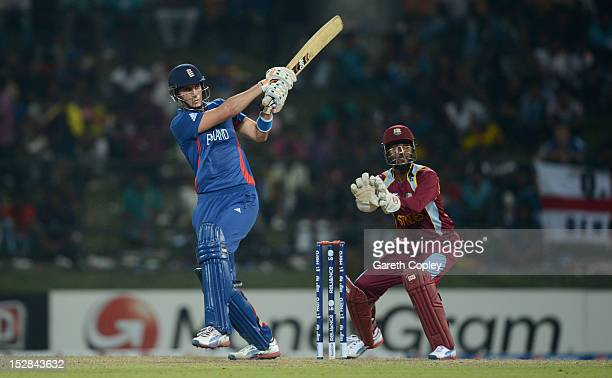 Alex Hales of England hits out for six runs watched by West Indies wicketkeeper Denesh Ramdin during the ICC World Twenty20 2012 Super Eights Group 1...