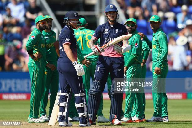 Alex Hales of England successfully asks for a review after being given out lbw off the bowling of Rumman Raees of Pakistan during the ICC Champions...