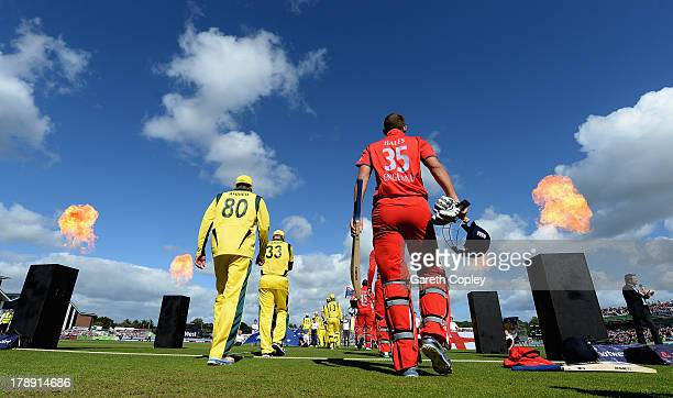 Alex Hales of England walks out alongside Fawad Ahmed of Australia during the 2nd NatWest Series T20 match between England and Australia at Emirates...
