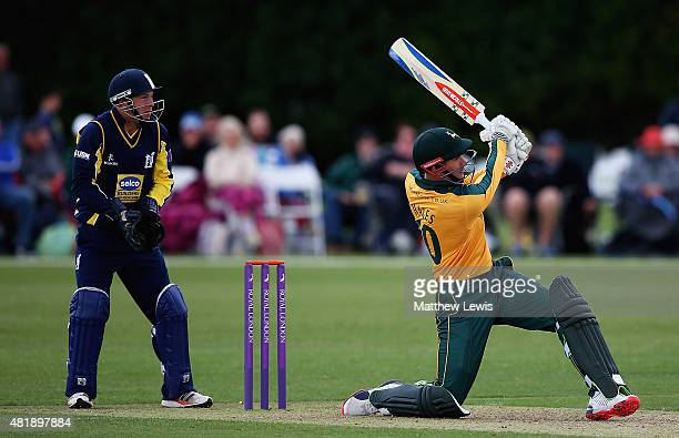 Alex Hales of Nottinghamshire hits a six as Tim Ambrose of Warwickshire looks on during the Royal London OneDay Cup match between Nottinghamshire and...