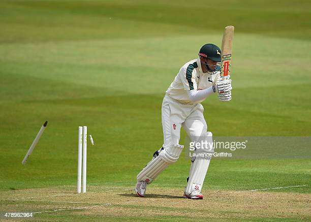 Alex Hales of Nottinghamshire is bowled by Joseph Leach of Worcestershire during the LV County Championship match between Nottinghamshire and...