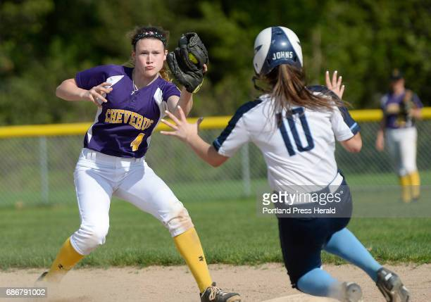 Alex Hammond of Cheverus prepares to tag out Angelica Johns after Johns was caught stealing Friday May 19 2017