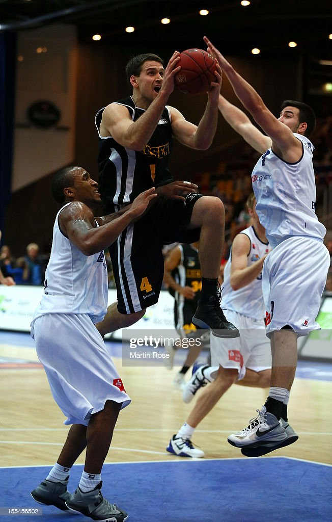 Alex Harris (L) of Bremerhaven challenges for the ball with John Turek (R) of Ludwigsburg during the Beko BBL basketball match between Eisbaeren Bremerhaven and Nackar RIESEN Ludwigsburg at the Stadthalle on November 4, 2012 in Bremerhaven, Germany.