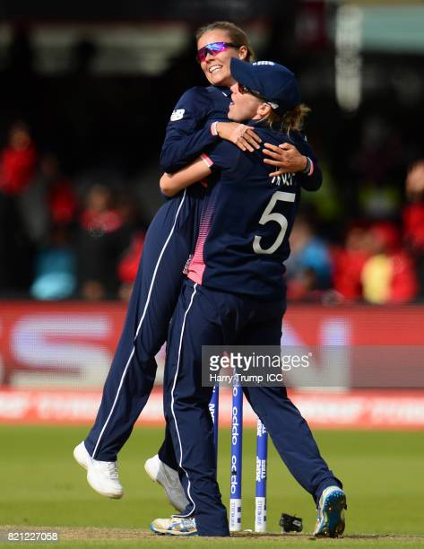 Alex Hartley and Heather Knight of England celebrate the wicket of Harmanpreet Kaut of India during the ICC Women's World Cup 2017 Final between...