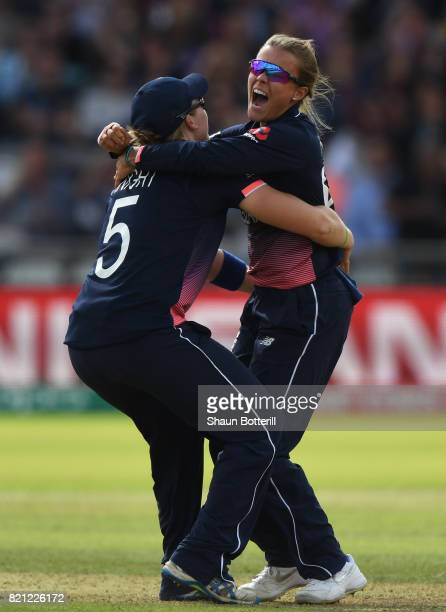 Alex Hartley of England celebrates with captain Heather Knight after taking the wicket of Harmanpreet Kaur of India during the ICC Women's World Cup...