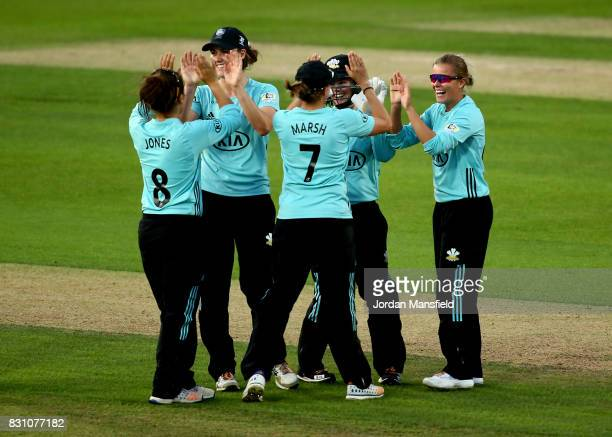 Alex Hartley of Surrey celebrates with her teammates after dismissing Hollie Armitage of Yorkshire during the Kia Super League match between Surrey...