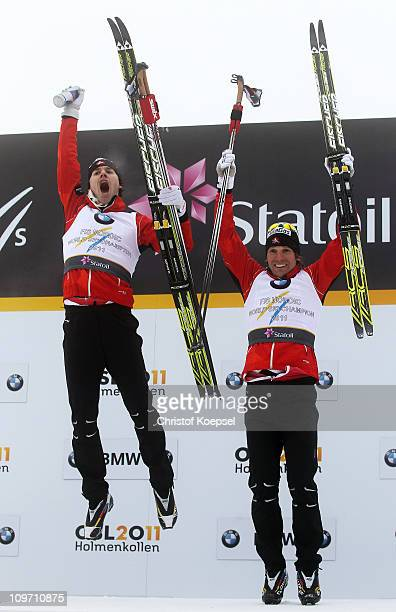 Alex Harvey and Devon Kershaw of Canada celebrate winning the gold medal following the Men's Cross Country Team Sprint race during the FIS Nordic...