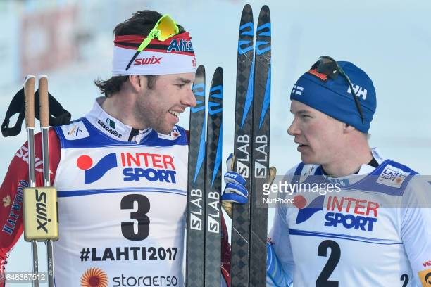 Alex Harvey from Canada and Matti Heikkinen from Finland after the end of Men crosscountry 50 km Mass Start Free final at FIS Nordic World Ski...