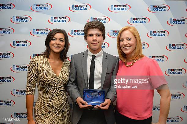 Alex Havers of Dersingham Cricket Club poses with his NatWest Young Volunteer Award and Lucy Verasamy and SarahJane Mee during the NatWest OSCA's...