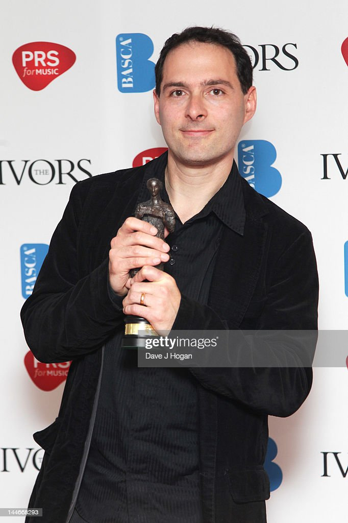 Alex Heffes poses with his Best Original Film Score Award in the press room at the Ivor Novello Awards 2012 at Grosvenor House on May 17, 2012 in London, England.