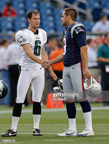 Alex Henery of the Philadelphia Eagles and Stephen Gostkowski of the New England Patriots chat before a game against the New England Patriots during...