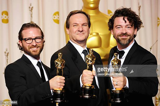 Alex Henning Rob Legato and Ben Grossman winners of the Visual Effects Award for 'Hugo' pose in the press room at the 84th Annual Academy Awards held...