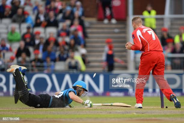 Alex Hepburn of Worcestershire Rapids dives into his crease during the NatWest T20 Blast match between Lancashire Lightning and Worcestershire Rapids...