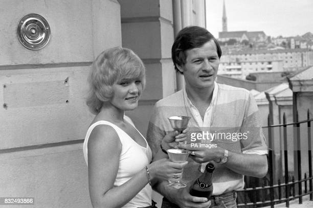 Alex Higgins and his fiancee Lynn Robbins drink a champagne toast after Higgins was found not guilty of assaulting a woman in his hotel bedroom