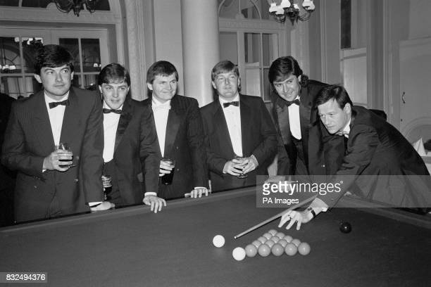 Alex Higgins lines up a shot watched by fellow snooker stars John Parrott Mark Bennett Eugene Hughes Dean Reynolds and Tony Knowles as they gather at...