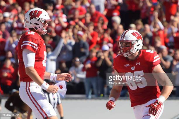 Alex Hornibrook celebrates a touchdown with Zander Neuville of the Wisconsin Badgers during the second quarter against the Maryland Terrapins at Camp...